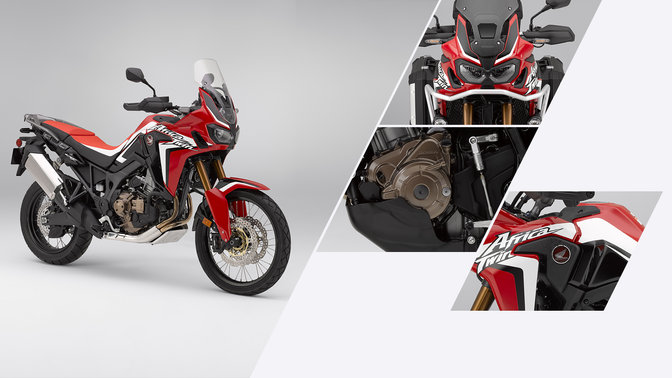 Front three-quarter facing Honda Africa Twin, close up of Honda Africa Twin badge, engine and headlights.